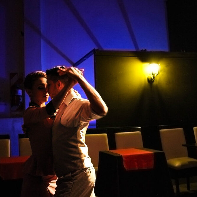 Dancers embraced in the art of tango.